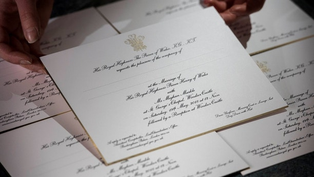 Invitations for Britain's Prince Harry and Meghan Markle's wedding in Windsor Castle in May, are seen after they have been printed at the workshop of Barnard and Westwood in London, March 22, 2018. Victoria Jones/Pool via Reuters - RC186CF7D7B0