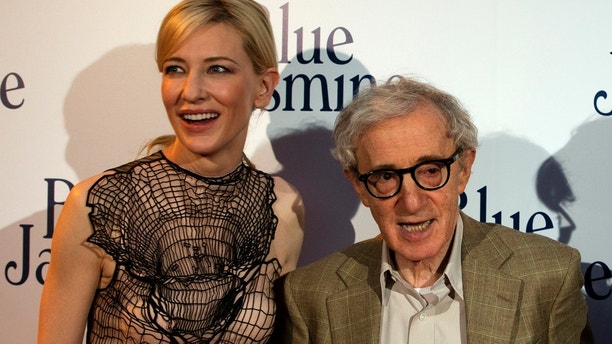"""U.S. director Woody Allen (R) and cast member Cate Blanchett pose during the premiere of the film """"Blue Jasmine"""" in Paris August 27, 2013. REUTERS/Charles Platiau (FRANCE - Tags: ENTERTAINMENT) - GM1E98S0COR01"""