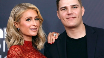 2018 iHeartRadio Music Awards - Arrivals – Los Angeles, California, U.S., 11/03/2018 – Paris Hilton and Chris Zylka. REUTERS/Mario Anzuoni - HP1EE3B1U6JOY