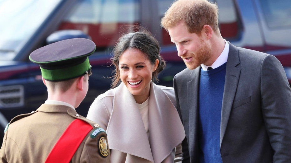 Britain's Prince Harry and Meghan Markle arrive for a visit to the Eikon Exhibition Centre in Lisburn, Northern Ireland  where they attended an event to mark the second year of youth-led peace-building initiative Amazing the Space Friday March 23, 2018. Prince Harry and Meghan will get married at St. George's Chapel in Windsor Castle on Saturday May 19.  (Brian Lawless/PA via AP)