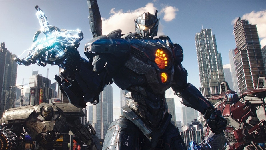 "This image released by Universal Pictures shows a scene from ""Pacific Rim Uprising."" (Legendary Pictures/Universal Pictures via AP)"