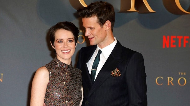 "FILE - In this Tuesday, Nov. 21, 2017 file photo, actors Claire Foy, left, and Matt Smith pose for photographers on arrival at the premiere of the series 'The Crown, Season 2' in central London. Producers of the Netflix drama ""The Crown"" apologized Tuesday to actors Claire Foy and Matt Smith over the revelation that Foy was paid less than her male co-star. (Photo by Grant Pollard/Invision/AP, File)"