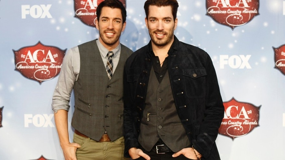Jonathan Scott (R), pictured here with his brother Drew (L), recently clapped back at his online haters.
