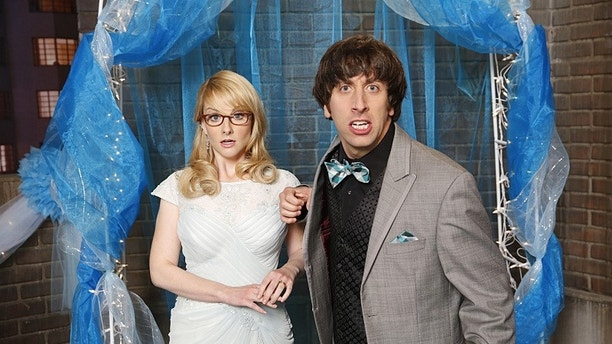 """""""The Prom Equivalency"""" -- When the gang recreates a high school prom on the roof the of the guys\' apartment building, Sheldon feels pressure to participate in all the typical romantic traditions, on THE BIG BANG THEORY, Thursday, Nov. 6 (8:00-8:31 PM, ET/PT), on the CBS Television Network. Pictured left to right: Melissa Rauch and Simon Helberg Photo: Monty Brinton/CBS ©2014 CBS Broadcasting, Inc. All Rights Reserved."""