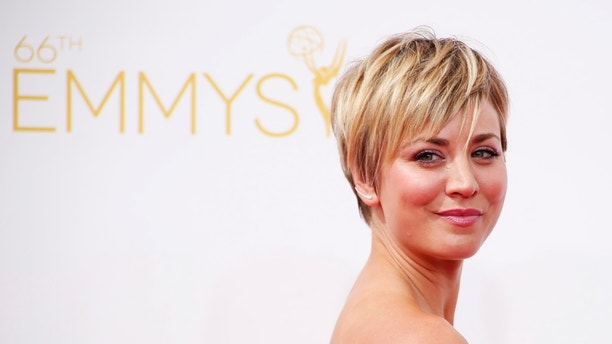 """Kaley Cuoco-Sweeting from the CBS sitcom """"The Big Bang Theory"""" arrives at the 66th Primetime Emmy Awards in Los Angeles, California August 25, 2014.  REUTERS/Lucy Nicholson (UNITED STATES -Tags: ENTERTAINMENT)(EMMYS-ARRIVALS) - RTR43Q10"""