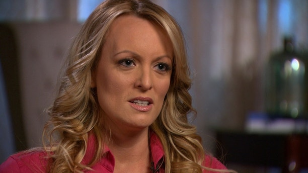 Stormy Daniels, an adult film star and director whose real name is Stephanie Clifford is interviewed by Anderson Cooper of CBS News' 60 Minutes program in early March 2018, in a still image from video provided March 25, 2018.   CBSNews/60 MINUTES/Handout via REUTERS. ATTENTION EDITOR - THIS IMAGE WAS TAKEN BY A THIRD PARTY. NO ARCHIVES, NO RESALES, MANDATORY CREDIT. - RC1679AF0440