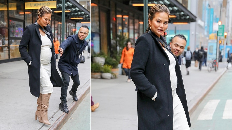 A stranger stops Chrissy Teigen from crossing the street in NYC. Teigen said the stranger saved her from being hit by a cyclist.