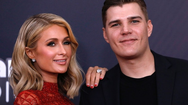 Paris Hilton and Chris Zylka arrive at the 2018 iHearRadio Music Awards in Los Angeles on March 11, 2018.