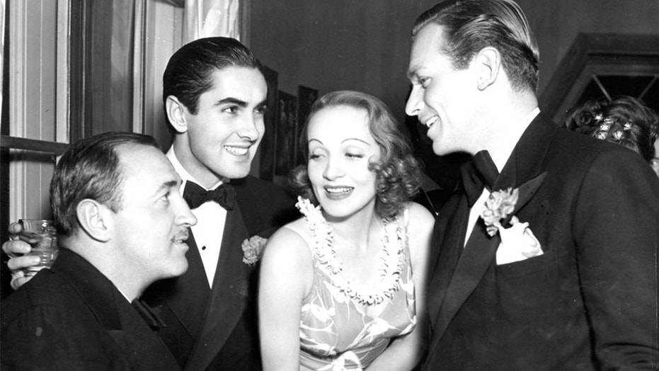 Marlene Dietrich surrounded by admirers.