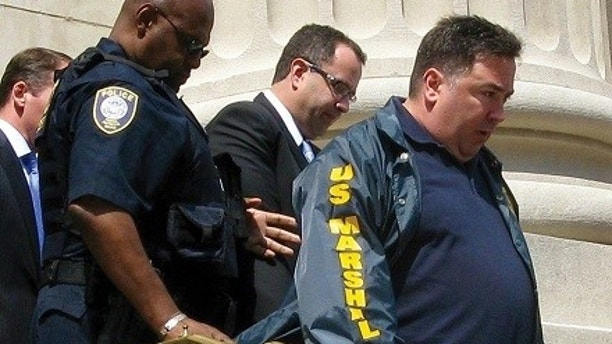 Jared Fogle is led from federal court in Indianapolis, Indiana August 19, 2015. REUTERS/Susan Guyett/File Photo - TM3EC9214LY01