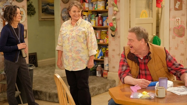 """ROSEANNE - """"Twenty Years to Life"""" - Roseanne and Dan adjust to living under the same roof with Darlene and her two children, Harris and Mark, when Darlene loses her job. Meanwhile, Becky announces she is going to be a surrogate to make extra money; and Roseanne and Jackie are at odds with one another, on the season premiere and first episode of the revival of """"Roseanne,"""" TUESDAY, MARCH 27 (8:00-8:30 p.m. EDT), on The ABC Television Network. (ABC/Adam Rose)SARA GILBERT, ROSEANE BARR, JOHN GOODMAN"""