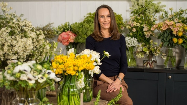 ATTENTION EDITORS - PICTURES EMBARGOED UNTIL 2301 GMT MARCH 31, 2018 AS REQUESTED BY KENSINGTON PALACE Florist Philippa Craddock, who has been chosen to create the floral displays for the wedding of Prince Harry and Meghan Markle, poses for a photograph in her studio in London, Britain, March 29, 2018. Picture taken March 29, 2018. Dominic Lipinski/Pool via Reuters TEMPLATE OUT - RC15BE2ABFC0
