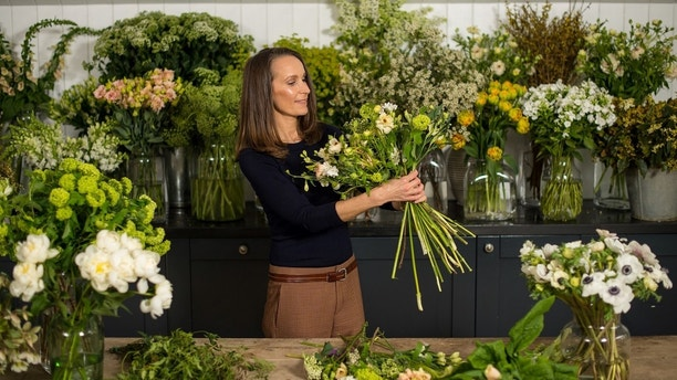ATTENTION EDITORS - PICTURES EMBARGOED UNTIL 2301 GMT MARCH 31, 2018 AS REQUESTED BY KENSINGTON PALACE Florist Philippa Craddock, who has been chosen to create the floral displays for the wedding of Prince Harry and Meghan Markle, poses for a photograph in her studio in London, Britain, March 29, 2018. Picture taken March 29, 2018. Dominic Lipinski/Pool via Reuters TEMPLATE OUT - RC11BE0C3330