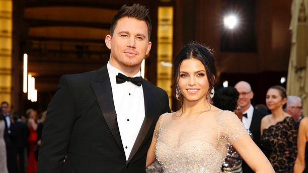 Presenter Channing Tatum and his wife Jenna Dewan arrive on the red carpet at the 86th Academy Awards in Hollywood, California March 2, 2014.  REUTERS/Mike Blake (UNITED STATES TAGS: ENTERTAINMENT) (OSCARS-ARRIVALS) - TB3EA33044F3G
