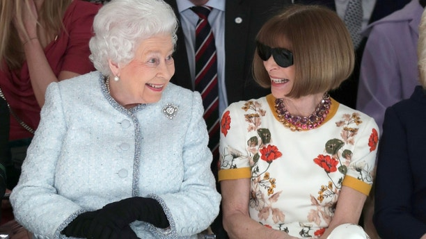 Britain's Queen Elizabeth II sits next to Vogue Editor-in-Chief Anna Wintour as they view Richard Quinn's runway show before presenting him with the inaugural Queen Elizabeth II Award for British Design as she visits London Fashion Week, in London, Britain February 20, 2018. REUTERS/Yui Mok/Pool     TPX IMAGES OF THE DAY - RC1731094F60