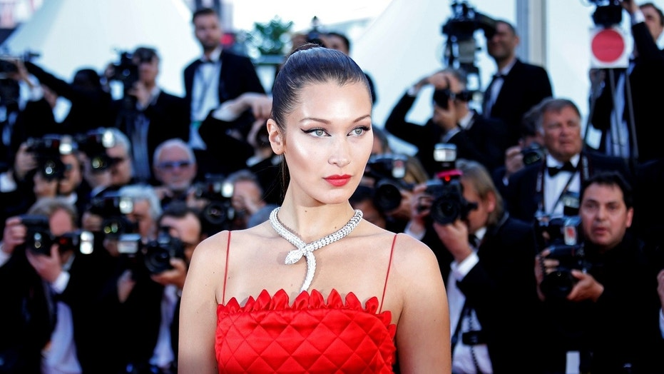 """Bella Hadid reportedly responded to an Instagram critic who called her and Kendall Jenner """"fake."""""""