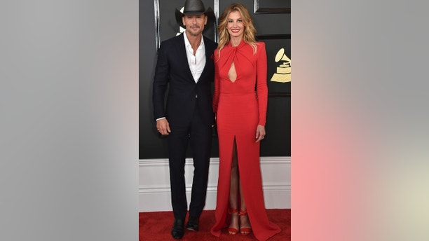 Tim McGraw, left, and Faith Hill arrive at the 59th annual Grammy Awards at the Staples Center on Sunday, Feb. 12, 2017, in Los Angeles. (Photo by Jordan Strauss/Invision/AP)