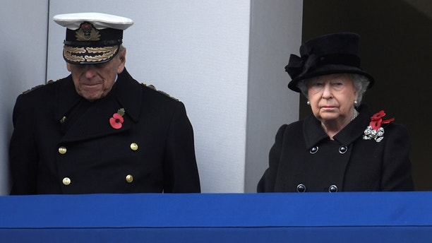 Britain's Queen Elizabeth II and Prince Philip, Duke of Edinburgh stand in silence at the Remembrance Sunday Cenotaph service in London, Britain, November 12, 2017. REUTERS/Toby Melville - RC183D17E600