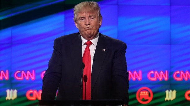 Republican U.S. presidential candidate Donald Trump reacts during the Republican candidates debate sponsored by CNN at the University of Miami in Miami, Florida, March 10, 2016.      REUTERS/Carlo Allegri - HP1EC3B0BIA00