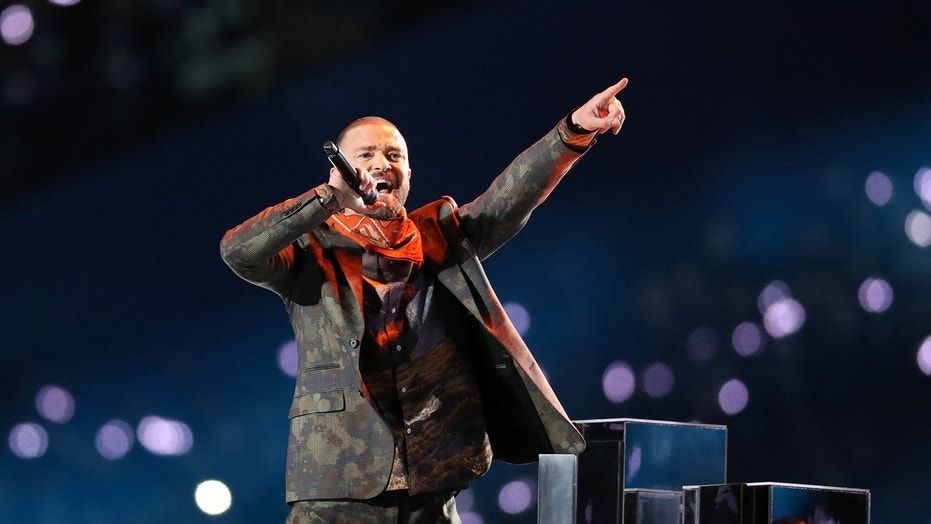 Pop star Justin Timberlake stopped his concert at Detroit's Little Caesars Arena Monday to help a fan make a special announcement -- there's a baby on the way.