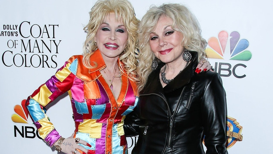 "Dolly Parton (left) and Stella Parton attend the Los Angeles Premiere Of Warner Bros. Television's ""Dolly Parton's Coat Of Many Colors"" held at the Egyptian Theatre on December 2, 2015."