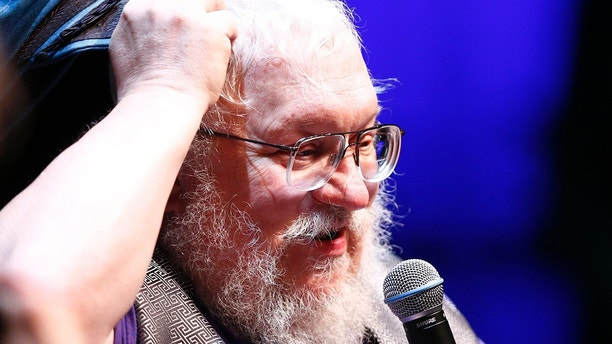 "George R.R. Martin, author of the ""Song of Ice and Fire"" fantasy series that is the basis of the television series ""Game of Thrones"", gestures during his masterclass at the Neuchatel International Fantastic Film Festival (NIFFF) in Neuchatel July 10, 2014. REUTERS/Denis Balibouse (SWITZERLAND - Tags: ENTERTAINMENT SOCIETY MEDIA) - GM1EA7A1R7N01"