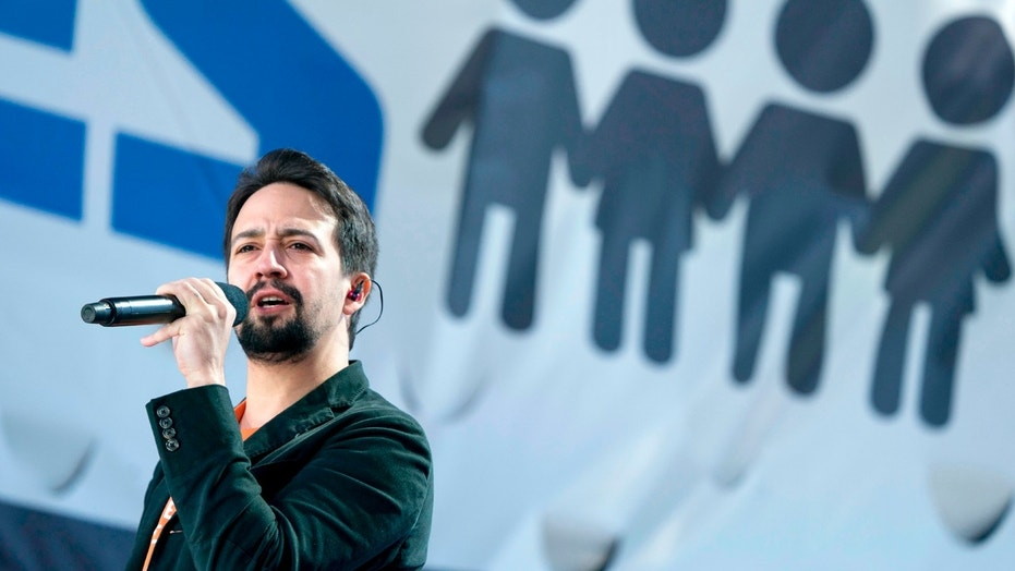 """FILE - In this March 24, 2018 file photo, Lin-Manuel Miranda performs """"Found Tonight"""" during the """"March for Our Lives"""" rally in support of gun control in Washington.  Miranda thought he had a migraine. But the Broadway star says it's really shingles.  Miranda tweeted on Thursday, April 6, the diagnosis was caught early, but he's been quarantined from his 8-week-old son.   (AP Photo/Andrew Harnik, File)"""