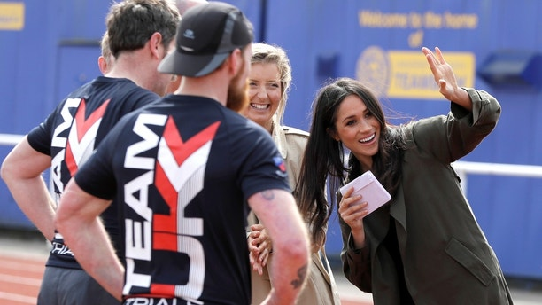 Meghan Markle waves during a visit to watch athletes at the team trials for the Invictus Games Sydney 2018 at the University of Bath Sports Training Village in Bath, Britain, April 6, 2018. Kirsty Wigglesworth/Pool via Reuters - RC1C7BFD62B0