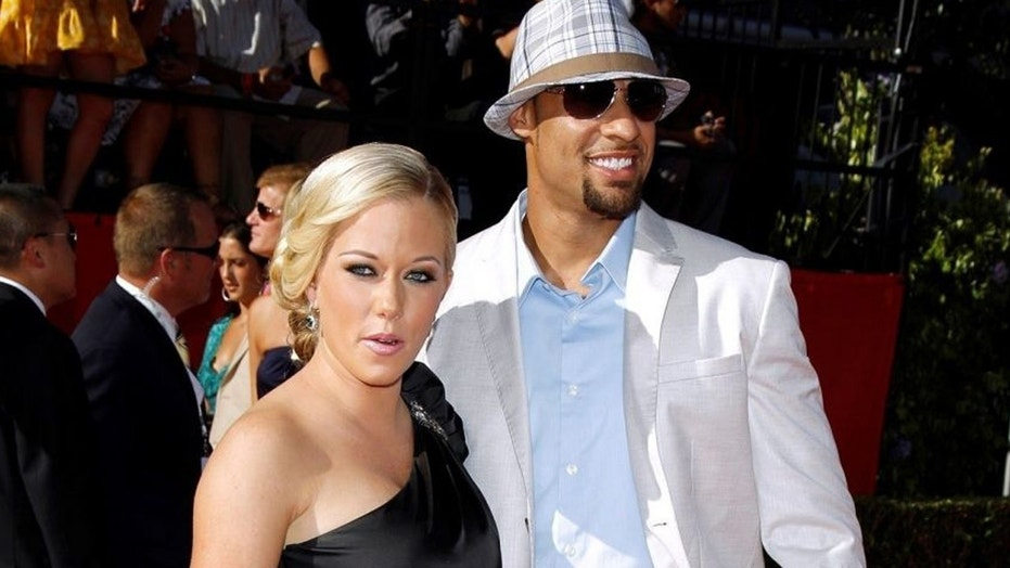 Kendra Wilkinson and Hank Baskett pose together in a 2009. Wilkinson announced her split from Baskett on Friday, April 6, 2018.