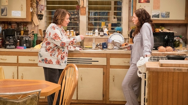 """ROSEANNE - """"Roseanne Gets the Chair"""" - Roseanne's clash with Darlene over how she's raising her kids - especially Harris - reaches a breaking point; while Dan tries to help Roseanne with her bad knee by getting her an elevator chair, which she refuses to use because she doesn't want to admit getting old, on the second episode of the revival of """"Roseanne,"""" TUESDAY, APRIL 3 (8:00-8:30 p.m. EDT), on The ABC Television Network. (ABC/Adam Rose)ROSEANNE BARR, EMMA KENNEY"""