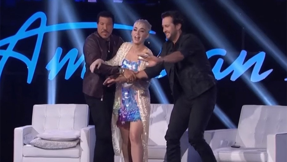 "Lionel Richie and Luke Bryan held Katy Perry back from ambushing a male ""American Idol"" contestant."