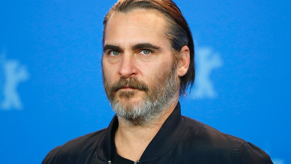 Actor Joaquin Phoenix poses during a photocall to promote the movie Don't Worry, He Won't Get Far on Foot at the 68th Berlinale International Film Festival in Berlin, Germany, February 20, 2018.