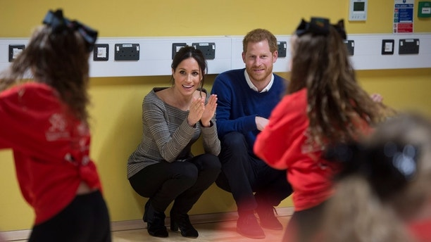 Britain's Prince Harry and his fiancee Meghan Markle attend a street dance class during their visit to Star Hub, a community and leisure centre, in Cardiff, Britain, January 18, 2018. REUTERS/Geoff Pugh/Pool - RC13B854F300