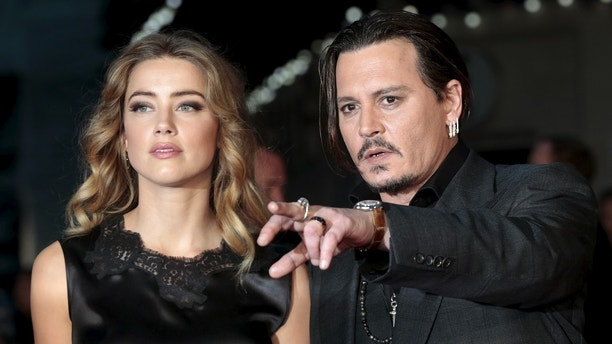 "Cast member Johnny Depp and his actress wife Amber Heard arrive for the premiere of the British film ""Black Mass"" in London, Britain October 11, 2015. REUTERS/Suzanne Plunkett - GF10000241391"