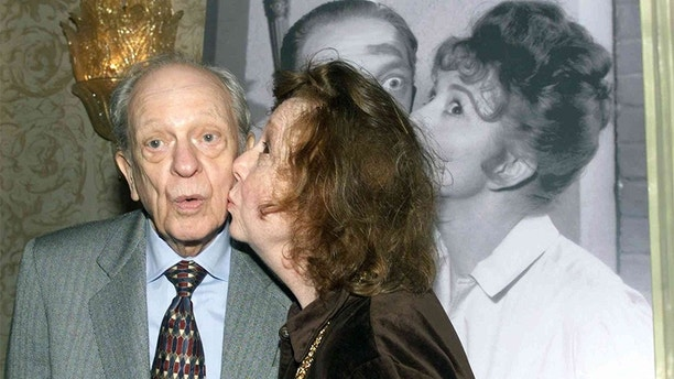 "Actor Don Knotts is kissed by actress Betty Lynn who portrayed Fife's girlfriend Thelma as they recreate a pose from a publicity photograph in this January 19, 2000 file photo. Knotts, who won five Emmys for portraying the bungling deputy Barney Fife on ""The Andy Griffith Show,"" has died, media reports said on February 25, 2006. He was 81. REUTERS/Rose Prouser/Files - RP3DSFDJCKAD"