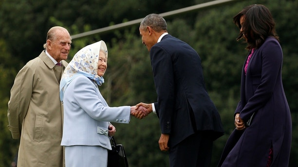 President Barack Obama and first lady Michelle Obama are greeted by Queen Elizabeth II and Prince Philip, Duke of Edinburgh upon their arrival for lunch at Windsor Castle in Windsor, Britain April 22, 2016.