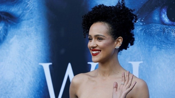Cast member Nathalie Emmanuel poses at a premiere for season 7 of the television series