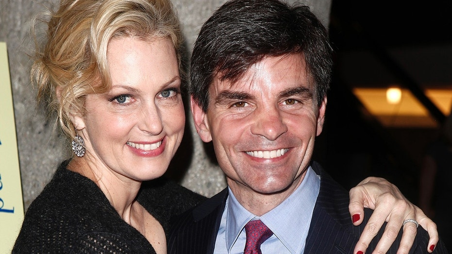 "Actress and author Ali Wentworth poses with her husband George Stephanopoulos at her ""Ali In Wonderland: And Other Tall Tales"" book launch at Sotheby's in New York February 6, 2012."
