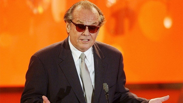 Actor Jack Nicholson accepts the best actor award for his role in