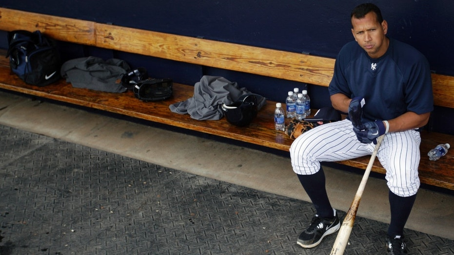 In this Feb. 25, 2012, file photo, New York Yankees' Alex Rodriguez sits in the dugout during practice at baseball spring training in Tampa, Fla.
