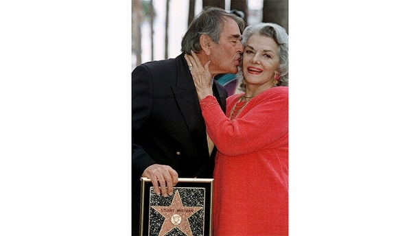 "Actor Stuart Whitman gives a kiss to his neighbour, actress Jane Russell, during the ceremony where he received his star on the Walk of Fame in Hollywood February 1. Today is the actor's 70th birthday and his is the 2,102nd star on the famous thoroughfare. Whitman has appeared in over 100 films since his first leading role in the 1956 film ""Johnny Trouble.
