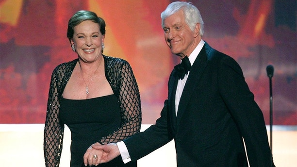 Actor Dick Van Dyke (R) and Julie Andrews hold hands after he presented her with the Life Achievement Award at the 13th Annual Screen Actors Guild Awards in Los Angeles January 28, 2007.     REUTERS/Robert Galbraith (UNITED STATES) - GM1DUMKFTRAA