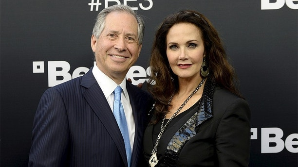Robert A. Altman, chairman and chief executive officer of ZeniMax Media, parent company of Bethesda Softworks, and his wife, actress Lynda Carter, pose during a media briefing by game publisher Bethesda Softworks before the opening day of the Electronic Entertainment Expo (E3), at the Dolby Theater in Los Angeles, California June 14, 2015. REUTERS/Kevork Djansezian - GF10000127874