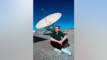 "In this March 7, 1997, photo, shows late night talk show host Art Bell near a satellite dish at his Pahrump, Nev., home. Bell, was the original owner of Pahrump based radio station KNYE 95.1 FM. And perhaps best known for his conspiracy theory in the paranormal, with his radio show ""Coast to Coast,"" which was syndicated across the nation. The Nye County Sheriff's Office says Bell died at his home in Pahrump, Nev. Bell is scheduled for an autopsy later this week to determine the cause of death. He was 72. (Aaron Mayes/Las Vegas Sun via AP)"