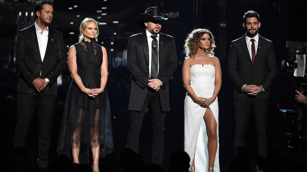 Luke Bryan, from left, Miranda Lambert, Jason Aldean, Maren Morris and Thomas Rhett speak at the 53rd annual Academy of Country Music Awards at the MGM Grand Garden Arena on Sunday, April 15, 2018, in Las Vegas.
