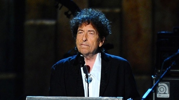 "FILE - In this Feb. 6, 2015 file photo, Bob Dylan accepts the 2015 MusiCares Person of the Year award at the 2015 MusiCares Person of the Year show in Los Angeles. Dylan, the winner of this year's Nobel Prize in literature declined the invitation to the Dec. 10 2016 prize ceremony and banquet, pleading other commitments. But the Nobel Foundation said Monday that Dylan has written a ""speech of thanks"" that will be read by a yet-to-be-decided person at the lavish banquet in Stockholm's City Hall. (Photo by Vince Bucci/Invision/AP, File)"