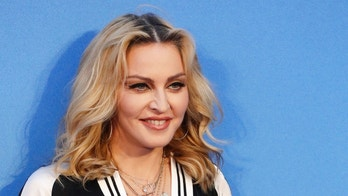 """FILE - In this Sept. 15, 2016 file photo, Madonna poses for photographers upon arrival at the World premiere of the film """"The Beatles, Eight Days a Week"""" in London.  Madonna is heading overseas to a new home in Portugal. The Michigan native had been living in New York. She said on Instagram Saturday, Sept. 2, 2017  that she finds the energy of Portugal inspiring, and it makes her feel creative and alive. (AP Photo/Kirsty Wigglesworth, File)"""