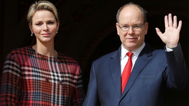 Prince Albert II of Monaco and his wife Princess Charlene stand on the palace balcony during the traditional Sainte Devote procession in Monaco, January 27, 2018.     REUTERS/Eric Gaillard - RC1BB46ACA80