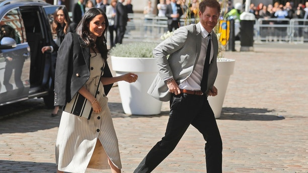 Britain's Prince Harry and his fiancee Meghan Markle arrive at the Queen Elizabeth II Center during the Commonwealth Heads of Government Meeting in London, Wednesday, April 18, 2018.(AP Photo/Frank Augstein)