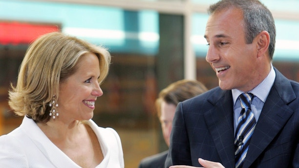 """Katie Couric (L) stands with her co-host Matt Lauer in the outside portion of the """"Today"""" set in New York's Rockefeller Plaza, May 31, 2006."""